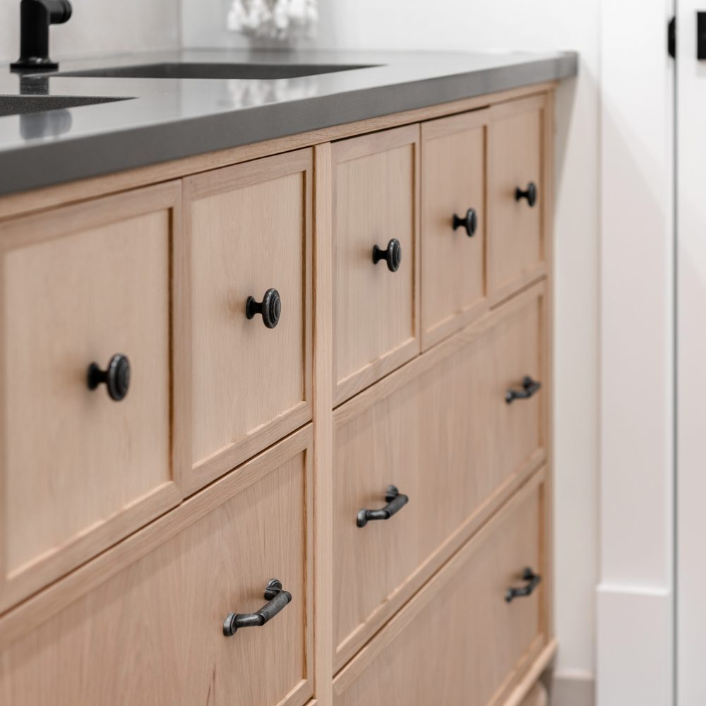Cabico Custom Cabinets - Oak Bay Village bathroom project – closeup side view of the cabinets