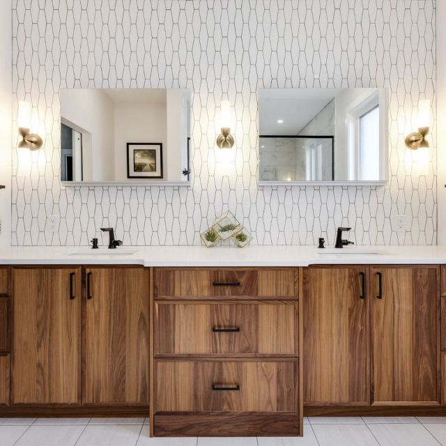 Style from start to finish.  . This eclectic ensuite bathroom project designed by @oakwooddesignandbuild features rustic grain-rich cabinetry and a bold backsplash. . Cabinetry: Unique Series Species: Black Walnut Door Style: 90 Colour: Natural . . . #CabicoCabinetry #HelloCabico #CustomKitchens #CustomCabinets #CustomCabinetry #CustomCabinetryDesign #CabinetGoals #BathroomCabinets #BathroomInspiration #BathroomInspo #BathroomDesign