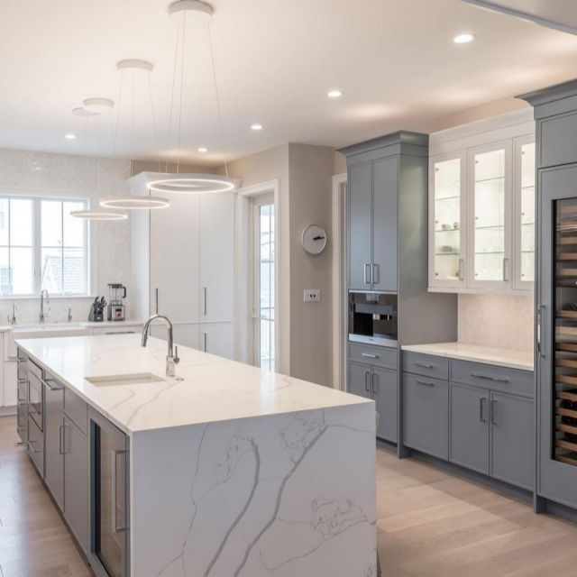 Water-falling in love with this kitchen. . @elena_pristine of @colmarkitchenstudio designed this kitchen with a waterfall island, two-toned cabinets with trim to match, and loads of storage! . Cabinetry: Unique Series Frameless Pure White and Ocean on MDF, 90 door style  . . . #CabicoCabinetry #HelloCabico #CustomKitchens #CustomCabinets #CustomCabinetry #CustomCabinetryDesign #CabinetGoals #KitchenCabinets #KitchenInspiration #KitchenInspo #KitchenDesign