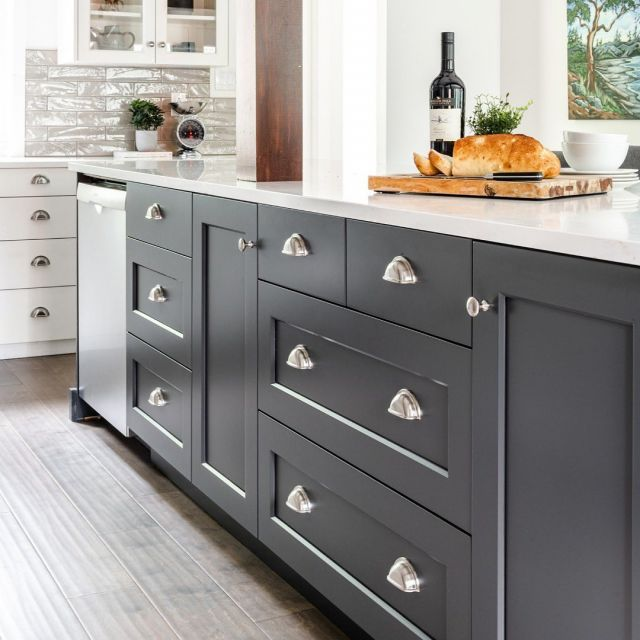 Drawers, doors, and storage oh my! . This storage-filled island designed by our friends at @thomasandbirchboutique wraps around an existing exposed beam - if that's not custom, we're not sure what is! . Cabinetry: Unique series Frameless Barcelona & Pure White Lacquer on Quarter Sawn Oak & MDF, 45 & 8000/K door styles . . . #CabicoCabinetry #HelloCabico #CustomKitchens #CustomCabinets #CustomCabinetry #CustomCabinetryDesign #CabinetGoals #KitchenCabinets #KitchenInspiration #KitchenInspo #KitchenDesign #KitchenIsland #IslandStorage #StorageOrganization