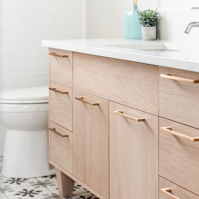 Calm the chaos of clutter. . This sleek Cabico vanity delivers maximum storage in a minimalist profile. Coordinating hardware completes the look for a clean and modern space.  . Courtesy of @thomasandbirchboutique Design: @ashybishop of @houseof4design Photo: @dashaaphotos . Cabinetry: Unique Series - Frameless, White Washed, White Oak, 55 door style . . . #CabicoCabinetry #HelloCabico #CustomKitchens #CustomCabinets #CustomCabinetry #CustomCabinetryDesign #CabinetGoals #KitchenCabinets #UniqueSeries #CabicoUnique